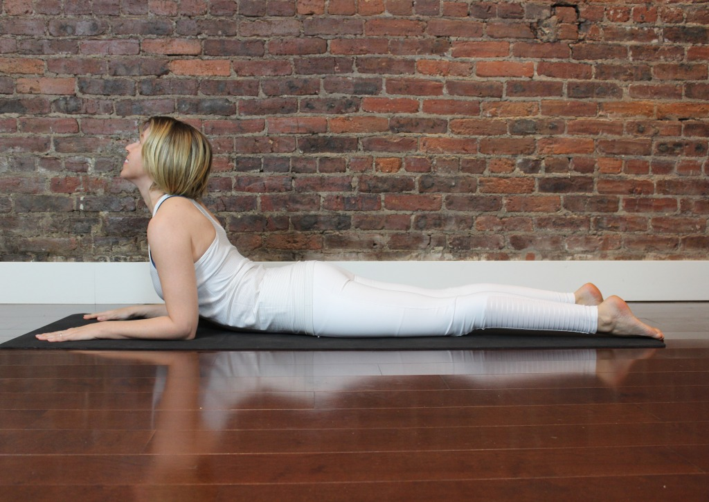 Bed Yoga Poses to Melt Away Neck and Shoulder Pain