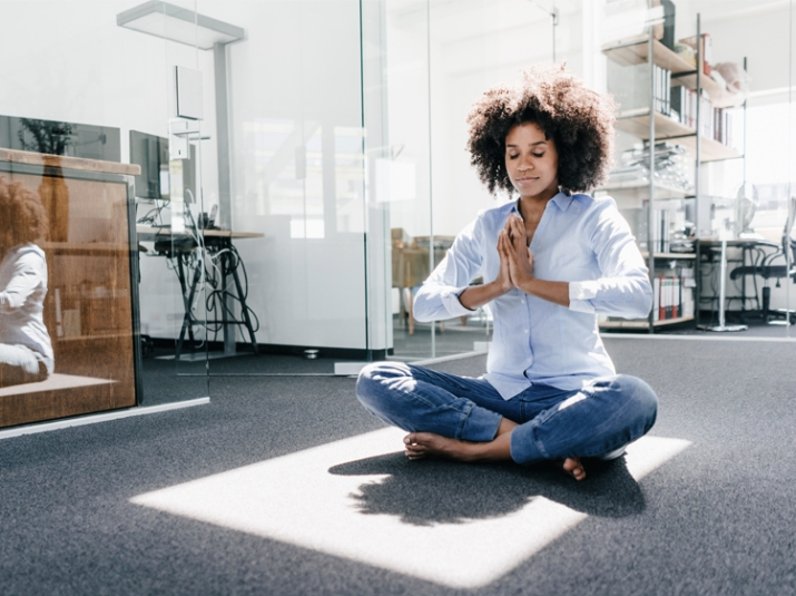 Do Yoga At Your Desk Without Looking Like A Weirdo