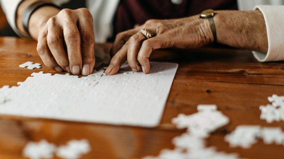 Old woman playing puzzle game