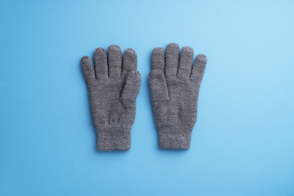 Directly Above Shot Of Gloves On Blue Background