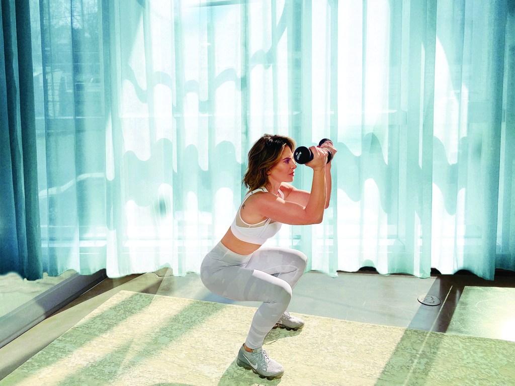 Jillian Michaels showing squat exercise