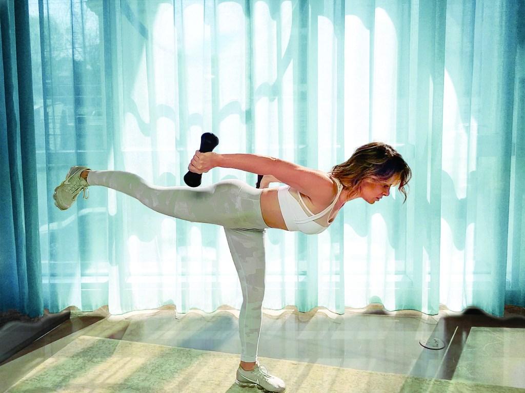 Jillian Michaels showing Warrior 3 exercise
