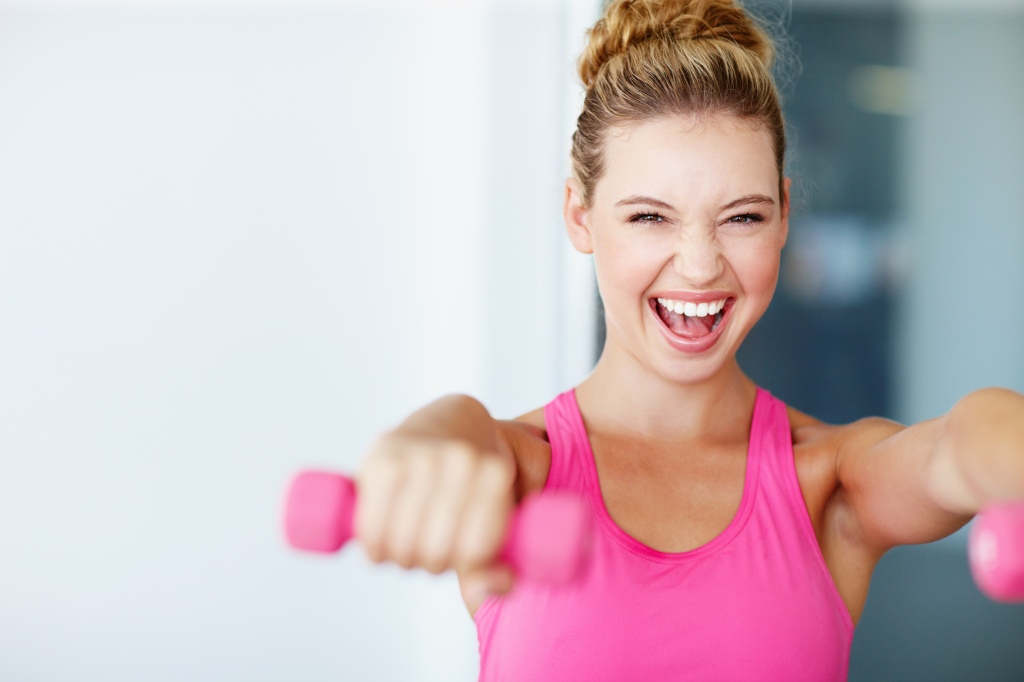 Woman working out with weights.