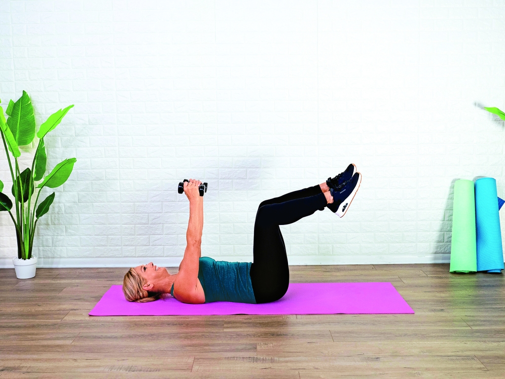 Denise Austin doing dumbbell chest flys