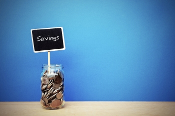 jar of coins with savings sign