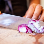 Woman cutting an onion