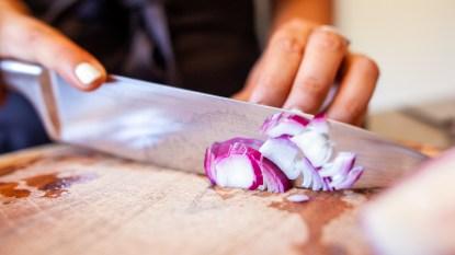 Woman cutting an onion