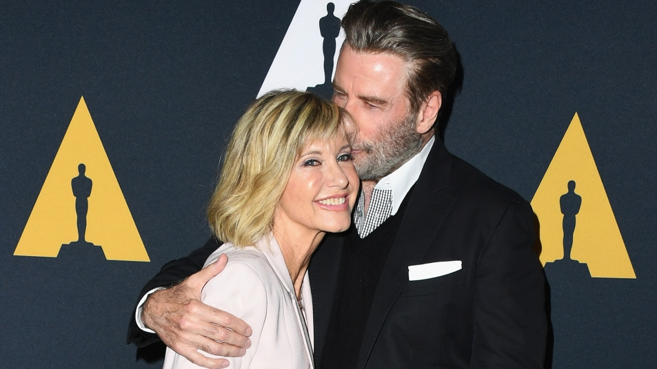 John Travolta giving Olivia Newton-John a kiss