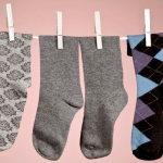 Socks on a clothesline with one missing