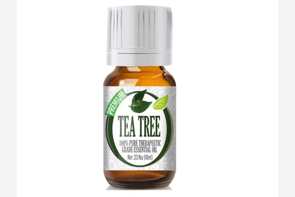 a bottle of tea tree oil with a label and white cap