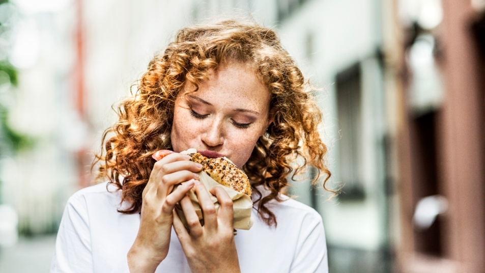 Woman eating a bagel