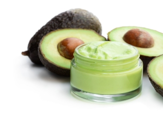 Homemade organic cosmetics with avocado on white background