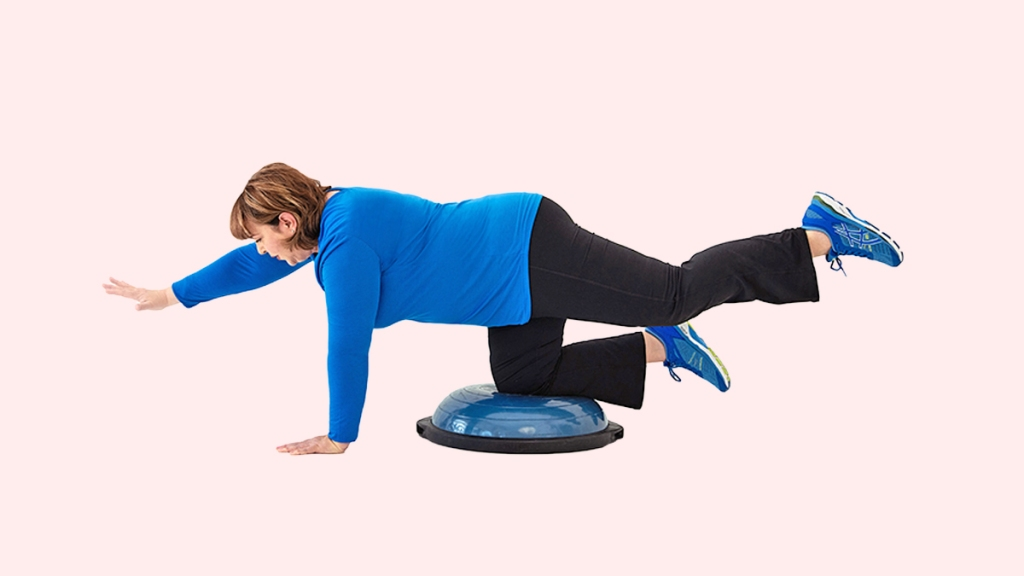 Woman working out on BUSO ball