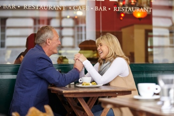 Couple Holding Hands Across Table on Date