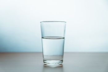Glass Of Water On Table Against Wall