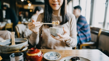 Woman eating Japanese food