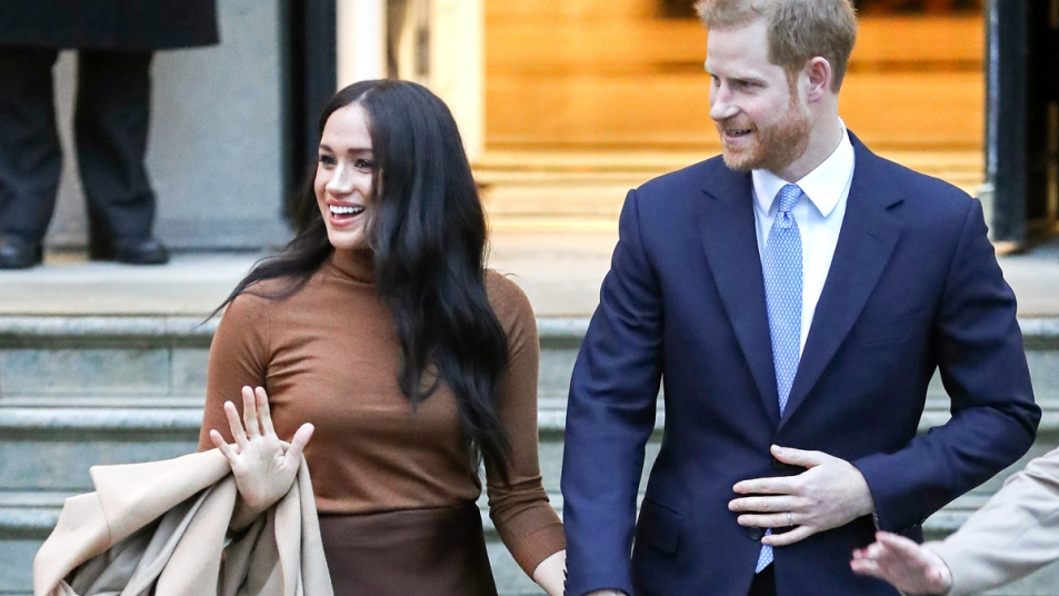 Prince Harry and Meghan Markle holding hands