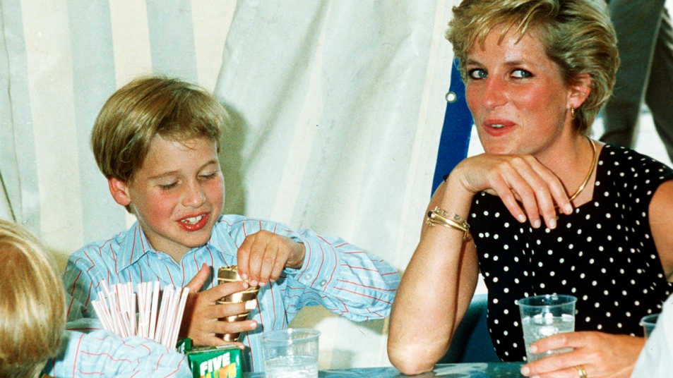 Princess Diana and young Prince William eating at a table