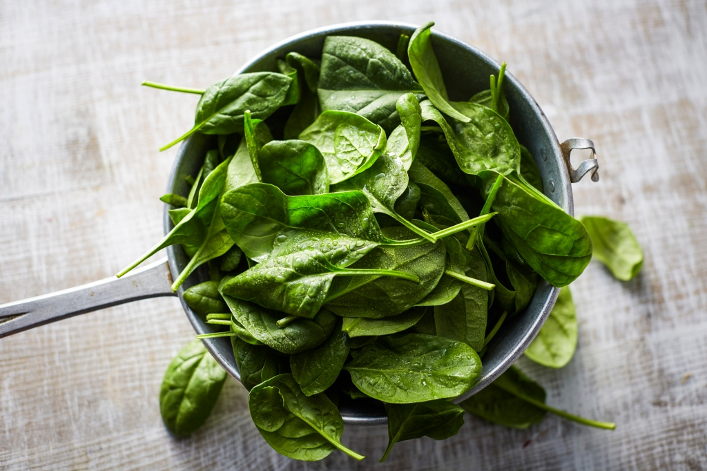 fresh spinach leaves in a pot