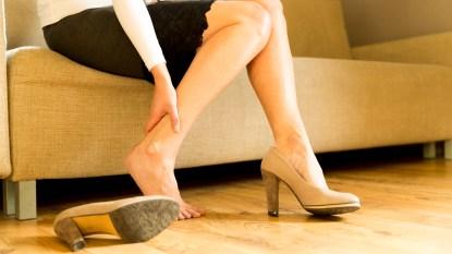 Woman rubbing her lower leg