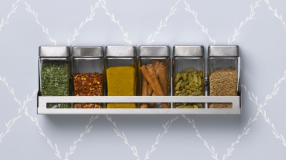 Spice rack hanging on wall
