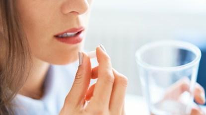 Woman taking pill