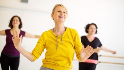 Energetic woman in exercise class