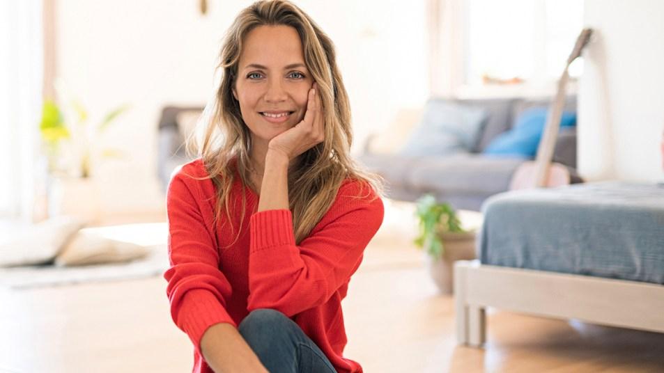 Smiling woman wearing red