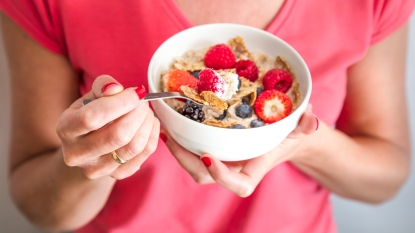 Woman holding bowl of cereal