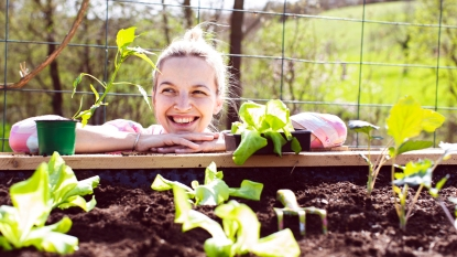 Woman smiling with plants