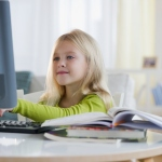 little blonde girl at computer