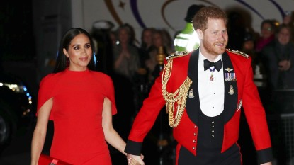 harry and meghan in red