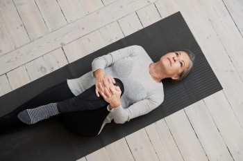 woman practicing pilates for back pain