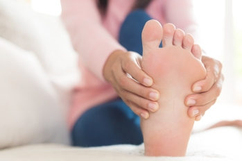 woman relieving sore feet