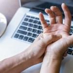 Woman clutching wrist