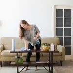 woman cleaning coffee table