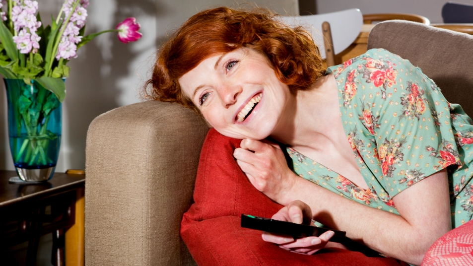 Woman smiling and watching TV