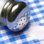 Salt spilling on table cloth