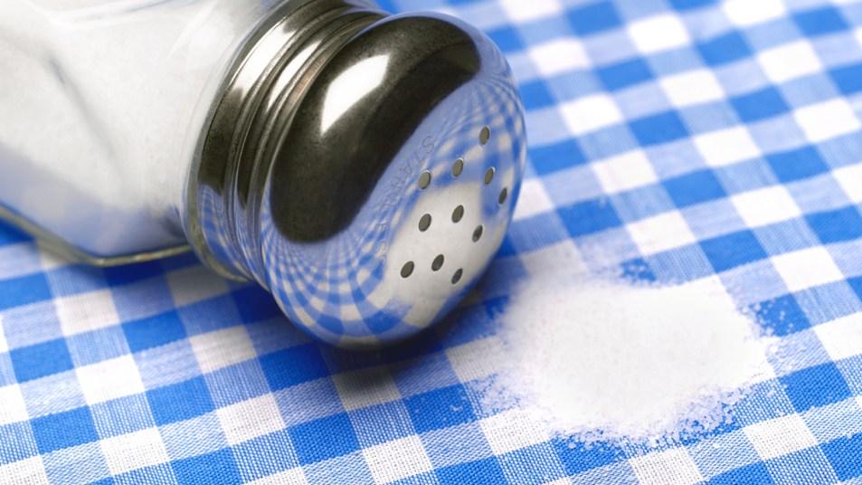 Salt spilling on table cloth