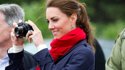 Kate Middleton holding a camera