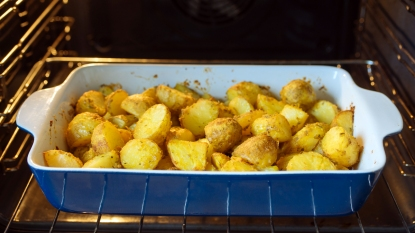 Potatoes roasting in an oven