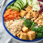 Bowl of quinoa, tofu, and broccoli