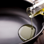 Pouring olive oil into cooking pan