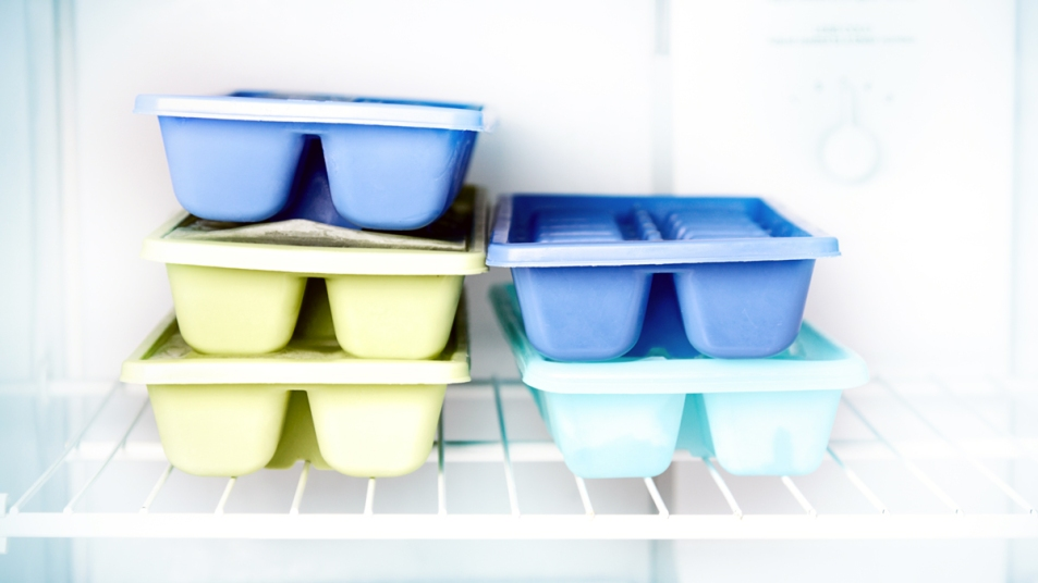 Ice trays stacked in freezer
