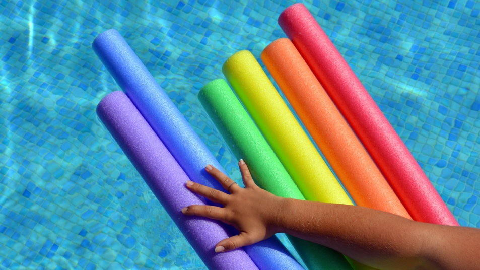 Pool noodles with hand grabbing for them