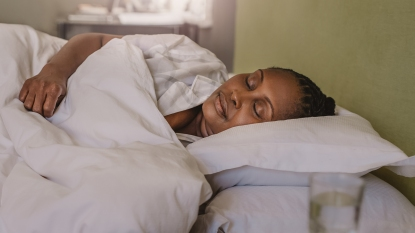 African American woman fast asleep in her bed