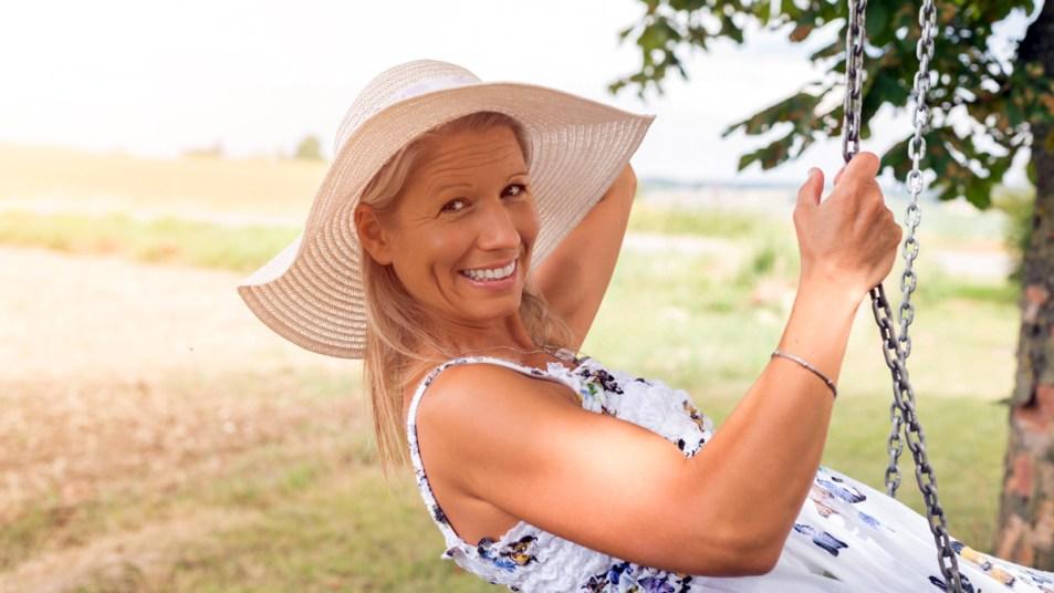 Woman in a sundress on a swing
