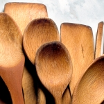 Variety of wooden spoons on a granite counter
