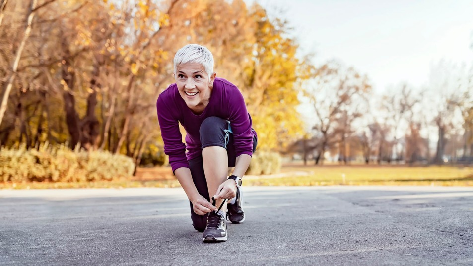 woman tying her running shoes before a run