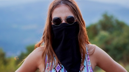 Woman wearing long neck gaiter mask